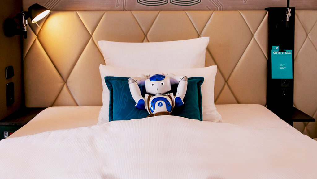 Sepp, Motel One's robot guest assistant, rests at one of the hotel suites